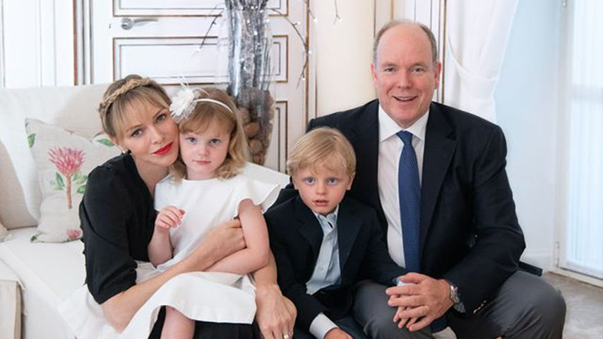 Princess Charlene with Prince Albert and their children