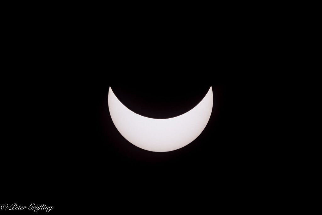 Partial eclipse of the sun darkens the sky today