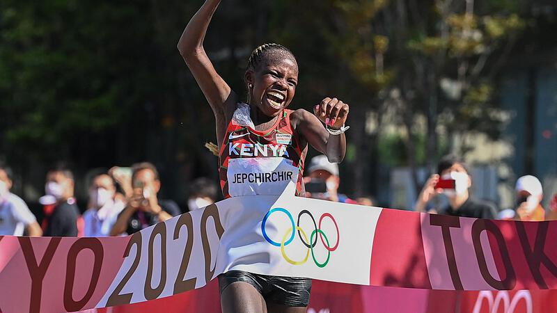 """in a """"frying pan"""" Kipchoge history books"""
