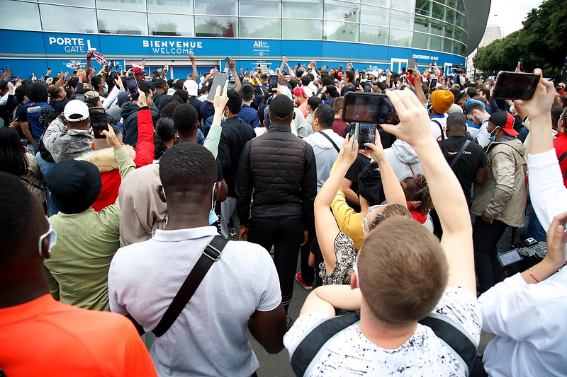 Fans wait in front of the Parc des Princes stadium in Paris